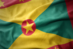Waving colorful flag of grenada. Royalty Free Stock Images