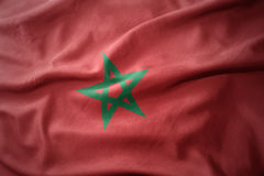 Waving colorful flag of morocco. Stock Photos