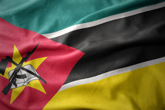 Waving colorful flag of mozambique. Stock Image
