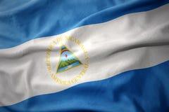 Waving colorful flag of nicaragua. Waving colorful national flag of nicaragua Royalty Free Stock Image