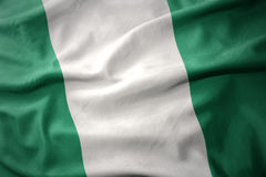 Waving colorful flag of nigeria. Waving colorful national flag of nigeria stock photography