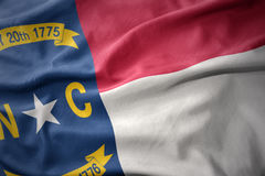 Waving colorful flag of north carolina state. Stock Photos