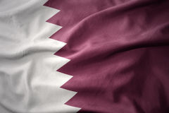 Waving colorful flag of qatar. Waving colorful national flag of qatar Stock Photo