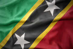 Waving colorful flag of saint kitts and nevis. Royalty Free Stock Photos