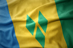 Waving colorful flag of saint vincent and the grenadines. Stock Images