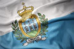 Waving colorful flag of san marino. Royalty Free Stock Image