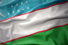 Waving colorful flag of uzbekistan. Waving colorful national flag of uzbekistan Stock Photos
