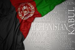 Waving colorful national flag of afghanistan on a gray background with important words about country. Concept royalty free stock photography