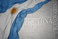 Waving colorful national flag of argentina on a gray background with important words about country. Concept stock images