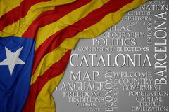 Waving colorful national flag of catalonia on a gray background with important words about country. Concept stock photo