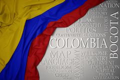 Waving colorful national flag of colombia on a gray background with important words about country. Concept royalty free stock photography