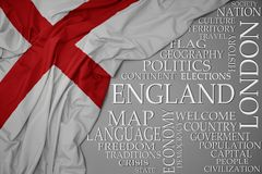 Waving colorful national flag of england on a gray background with important words about country. Concept royalty free stock image