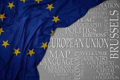 Waving colorful national flag of european union on a gray background with important words about country. Concept stock image