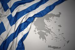 Waving colorful national flag and map of greece. Waving colorful national flag of greece on a gray map background royalty free stock photography