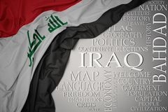 Waving colorful national flag of iraq on a gray background with important words about country. Concept stock images