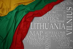 Waving colorful national flag of lithuania on a gray background with important words about country. Concept royalty free stock images