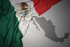 Waving colorful national flag and map of mexico. Waving colorful national flag of mexico on a gray map background royalty free stock images