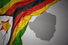 Waving colorful national flag and map of zimbabwe. Royalty Free Illustration