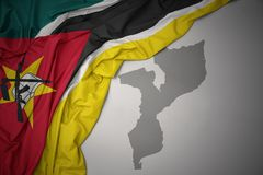 Waving colorful national flag and map of mozambique. Stock Illustration