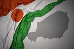 Waving colorful national flag and map of niger. Royalty Free Illustration