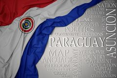 Waving colorful national flag of paraguay on a gray background with important words about country. Concept royalty free stock photo