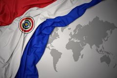 Waving colorful national flag of paraguay. Stock Photos