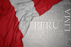 Waving colorful national flag of peru on a gray background with important words about country. Concept royalty free stock images