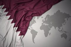 Waving colorful national flag of qatar. Stock Photo