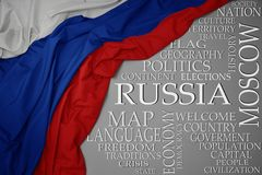 Waving colorful national flag of russia on a gray background with important words about country. Concept royalty free stock photos
