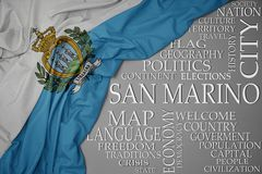 Waving colorful national flag of san marino on a gray background with important words about country. Concept stock images