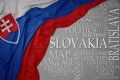 Waving colorful national flag of slovakia on a gray background with important words about country. Concept royalty free stock photo