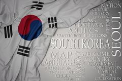 Waving colorful national flag of south korea on a gray background with important words about country. Concept stock photos