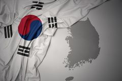 Waving colorful national flag and map of south korea. stock photography
