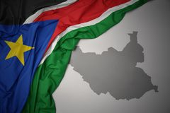 Waving colorful national flag and map of south sudan. Vector Illustration