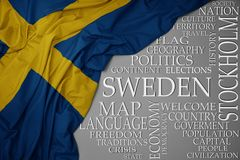 Waving colorful national flag of sweden on a gray background with important words about country. Concept stock images