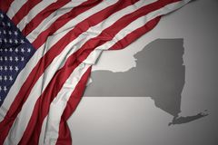 Waving national flag of united states of america on a gray new york state map background. Waving colorful national flag of united states of america on a gray stock image