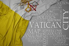Waving colorful national flag of vatican city on a gray background with important words about country. Concept stock photos
