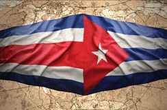 Costa Rica and Cuba. Waving Costa Rica and Cuban flags on the of the political map of the world Royalty Free Stock Photos