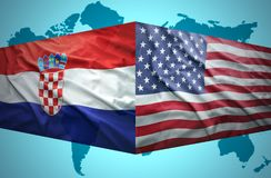 Waving Croatian and American flags. Of the political map of the world Stock Images