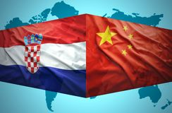 Waving Croatian and Chinese flags. Of the political map of the world Stock Photos