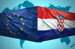 Waving Croatian and European Union flags Stock Photo