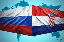 Waving Croatian and Russian flags Stock Photo