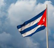 Waving cuban flag flying over Revolution Square in Havana Cuba. Waving cuban flag flying over Revolution Square in historic Havana, Cuba royalty free stock images
