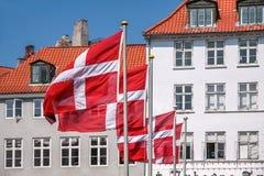 Waving Danish flag. Danish flag waving, in the Nyhavn district of Copenhagen, Denmark Royalty Free Stock Photo