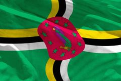 Waving Dominica flag for using as texture or background, the flag is fluttering on the wind. Fluttering Dominica flag for using as texture or background, the royalty free stock photos