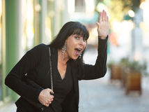 Waving on a Downtown Street Stock Photography
