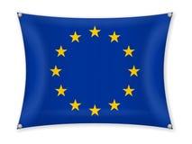 Waving EU flag. On a white background Stock Photos