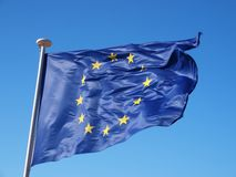 Waving Europe flag. A shot of the European flag on bright blue sky Royalty Free Stock Photos