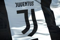 Waving fabric texture flag of juventus football club, real textu Stock Image