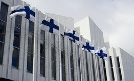 Waving Finnish flags against of The Finlandia Hall Royalty Free Stock Photo